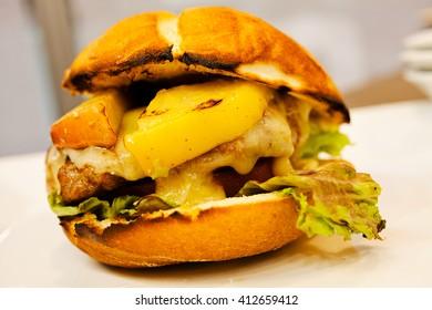 Big sandwich - hamburger with beef burger, cheese and tomato