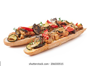 Big sandwich with roasted vegetables (zucchini, eggplant, tomatoes) with cheese and thyme on white background