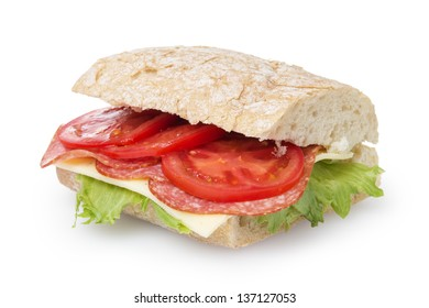big sandwich with salami cheese tomato and salad leaves on ciabatta bread, isolated