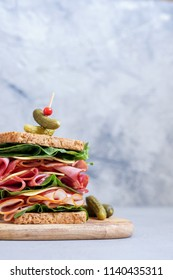 Big sandwich stack with ham, deli meat, cheese and vegetables