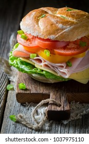 Big sandwich with tomatoes, cheese and ham