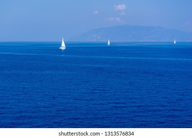 the big sea landscape with small yachts on the horizon and is a lot of blank space