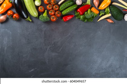 Big set of fresh vegetables on a black background