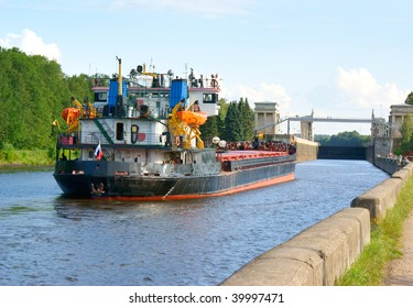 Big ship on the river under blue sky