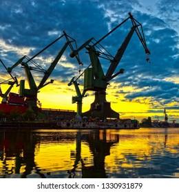 Big shipyard cranes at sunset in Gdansk, Poland.