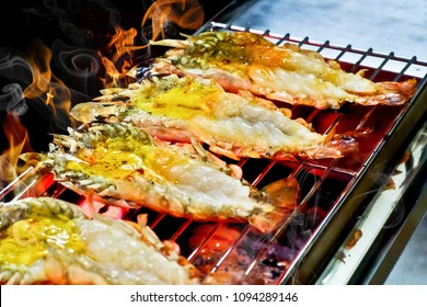 big shrimp or prawn roast on a grill. Have a hot fire, burn the shrimp. concept: food,cooking