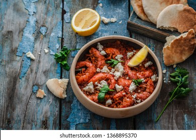 Big shrimps in tomato sauce with feta cheese or saganaki, copy space