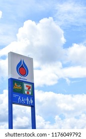Big sign in front of PTT petrol station on blue sky and white clouds background.PTT Public Company Limited is a Thai state-owned SET-listed oil and gas company.Sep 10,2018 : Chiang Mai,Thailand.