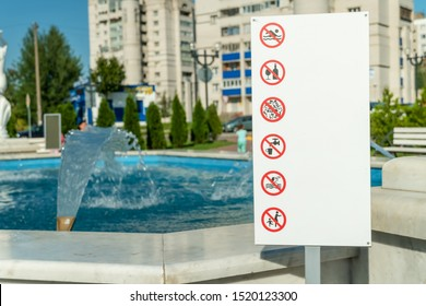 Big sign near the fountain closeup prohibiting: swimming, smoking, drinking alcohol, littering, children without adults, drinking water from the fountain