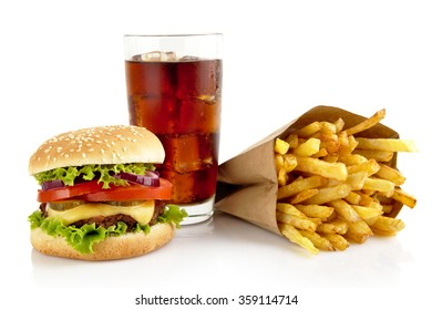 Big single cheeseburger with glass of cola and french fries isolated on white background