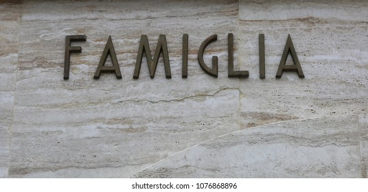 big single word FAMIGLIA that means family in Italian Language