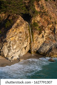 Big Sir, California - 6 July 2015: Sunset at McWay Falls in the Julia Pfeiffer Burns State Park along the Pacific Coast Highway