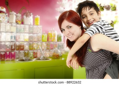 Big sister or babysitter taking younger brother to the candy store.