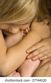 Big sister hugging baby brother