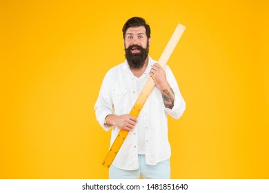 Big size. Measure and control. Geometry theorem. Actual size. School teacher. Small little big large. Does size really matter. Man bearded hipster holding ruler. Measure length. Size tall and length.