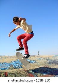 Big skate park showing a boy skating