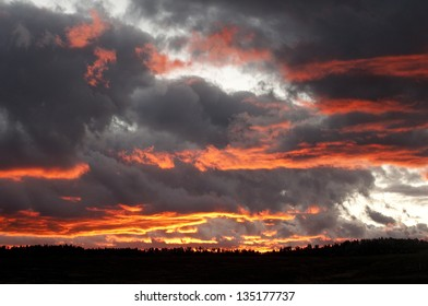 Big Sky Country as storm clouds lift at sunset/Radiant Sky/Here on the Colorado Plateau, where the wind keeps rolling, the storm clouds fill the sky and the sunset makes it all come alive.