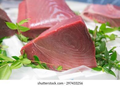A big slice of red tuna fish