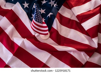 Big and small american flag as background