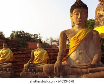 Big and small Buddha in Wat Yai Chai Mongkol temple, Ayuthaya Thailand