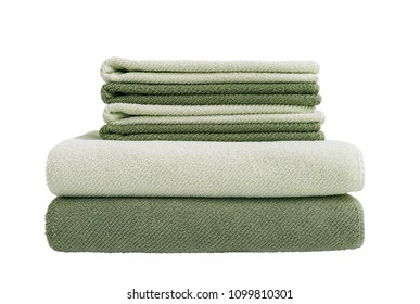Big and small green bath towels in stack. Six towels in stack. Isolated over white background