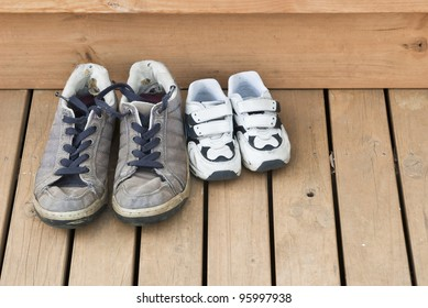 Big and small shoes on the back deck