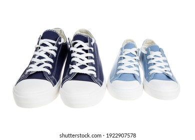 Big and small shoes, sneakers, isolated on white