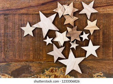 Big and small wooden stars on a vintage wooden table