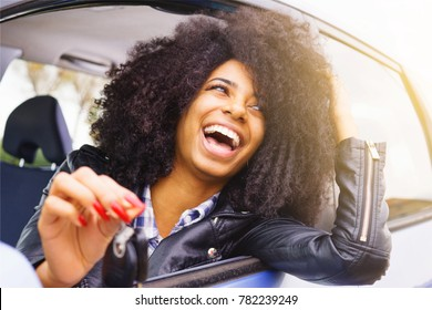 big smile, afro hair girl with beautiful bright teeth. stylish black girl happy sitting in her car