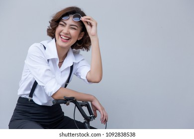 big smile face from attractive asian lady on bycicle hand on blank background. Happy people action with healthy face with good.