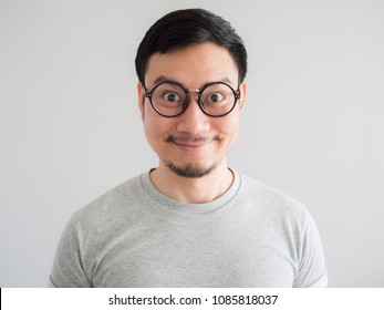 Big smile face of very happy Asian man with eyeglasses.