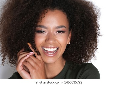 Big smile from thus beautiful afro-amercian model.