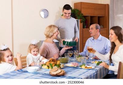 Big smiling family celebrating birthday at festive dinner