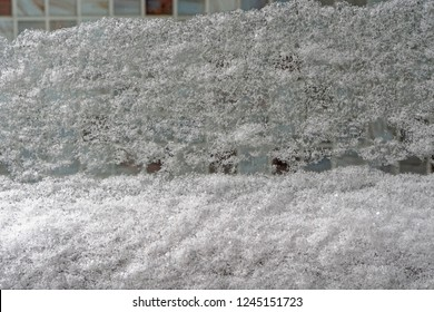 Big snow cover at window in winter