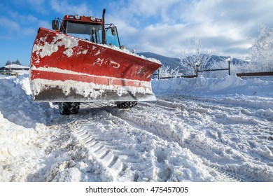 Big snow plough on snowy road