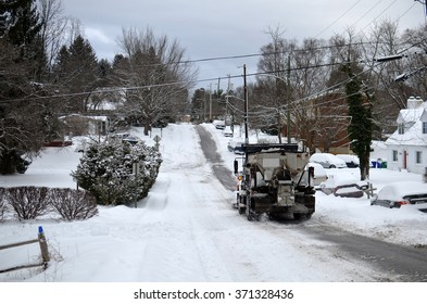 Big snow plow cleaning the roads after a huge snow storm in Blacksburg, Virginia, USA
