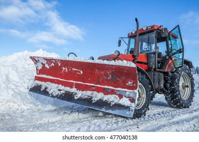 Big snow plow on snowy road