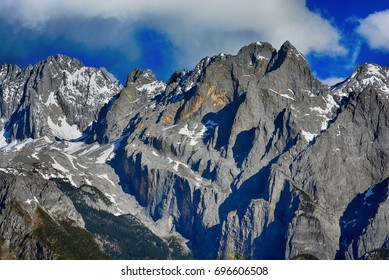 Big snow stone mountain and forest mountain with blue sky and cloudy