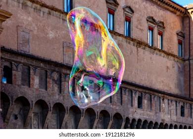 Big Soap Bubble in Piazza Maggiore, Bologna, Italy