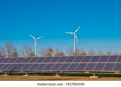 Big solar power plant and wind turbines as universal green ecofriendly energy solution in Magdeburg, Germany. Concept of energy and sustainable living