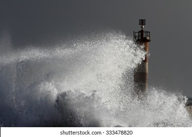 Big splashing wave closeup in a stormy evening (focus on the wave). North of Portugal.