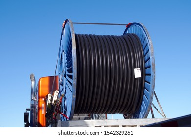 big spool of electric wire on a truck