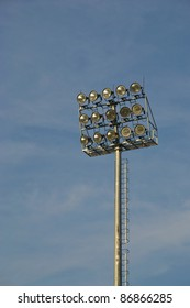 Big sport light against blue sky.