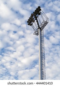big sport light pole, white small cloud on blue sky in day light atmosphere air
