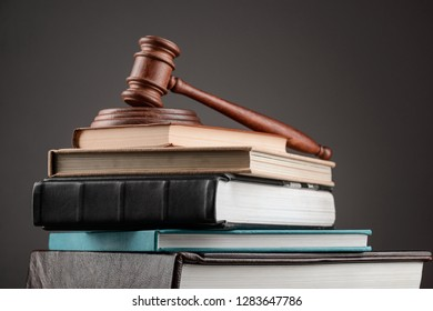 Big stack of books and gavel on top. Law and jurisprudence education concept.