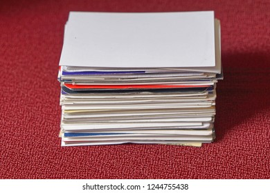Big stack of business cards at red table