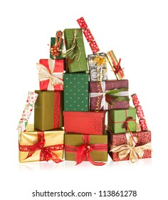 Big stack of christmas presents in the shape of a high mountain