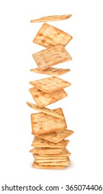 big stack of crackers falling from a height on an isolated white background