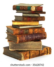 Big stack of old, antique books on white background