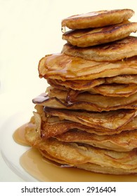 A big stack of pancakes with maple syrup